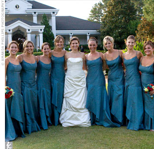 Bouquets of lime, red and blue flowers complemented the bridesmaid's spaghetti strap, floor-length gowns.