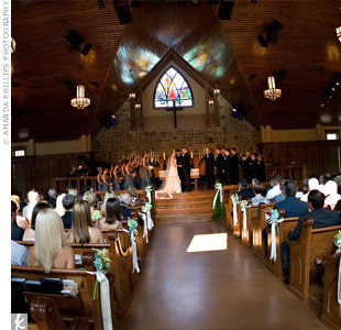 "The couple exchanged vows in a traditional church ceremony, and they lit a unity candle while the song ""I Can't Help Falling in Love With You"" by Elvis was played on the piano."
