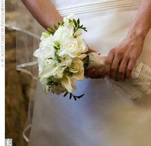 Robin carried a bouquet of white ranunculus, calla lilies, Eskimo roses and white freesias.