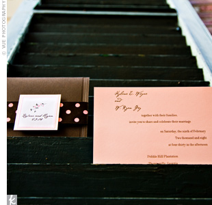 Brown envelopes sealed with pink and brown polka dot ribbons and customized labels held the pink invitations.