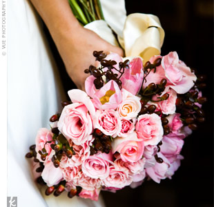 Kylene decided on a lush bouquet of pink roses, double-ruffle tulips and hypericum berries.