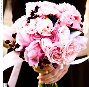 The bridesmaids carried mini versions of the bride's pink and white bouquet.