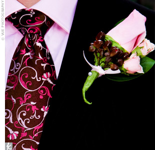 Pink roses and brown berries decorated the guys' lapels.