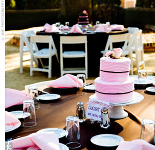In lieu of flowers or candles, a two-tiered round cake iced in pink or brown topped each table.