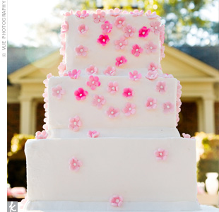 Pink sugar flowers decorated the three-tiered, buttercream cake.