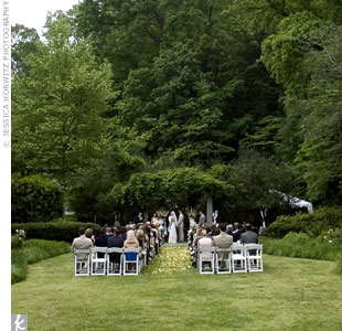 "The couple exchanged traditional vows in an outdoor ceremony that included a special ""blessing of the rings"" by the mothers of the bride and groom."