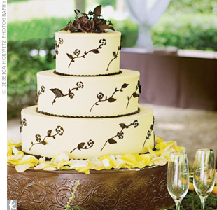 Brown sugar leaves and flowers adorned the three tiers of the buttercream frosted cake.