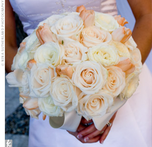 In honor of the groom's Dutch heritage, the bride carried the traditional flower of The Netherlands -- the tulip -- along with Vendela roses and Snowy Jewel roses.