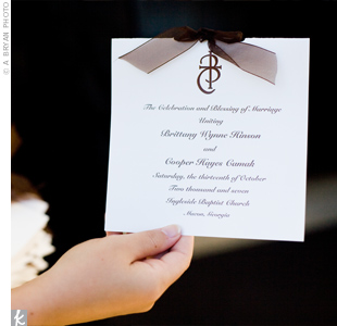Sheer, chocolate-colored ribbon was tied at the top of the classic ivory programs.