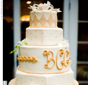 Carmel-colored diamonds, dots and an iced monogram decorated the round and hexagon layers on the five-tiered cake.