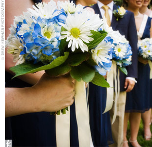 Inspired by bright summer blooms, the bridesmaids carried blue hydrangea and white daisy bouquets.