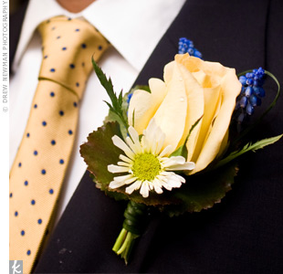 Blue hyacinth, a yellow rose and a miniature daisy decorated the groom's lapel.
