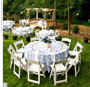 The ceremony area was turned over quickly into a reception spot with tables covered in blue-and-white gingham print tablecloths and surrounded by white wooden folding chairs.