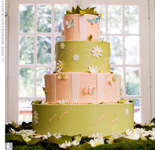 Gum paste daisies, bumble bees and butterflies covered the four-tiered, pink-and-green frosted cake.