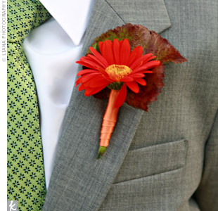 The two ring bearers wore single gerbera daisies on the lapels of their gray suits.