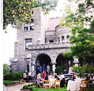 Tables draped with cream linens were set up on the lawn outside of the four-story historic Rhodes Hall.