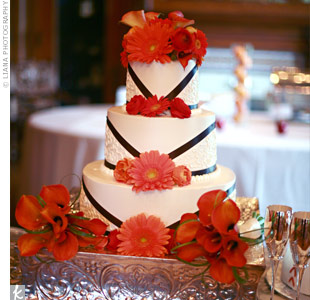 Orange calla lilies, gerbera daisies, ranunculuses and a chocolate ribbon design decorated the three-tiered, buttercream cake.