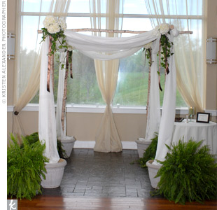 The ceremony took place under a birch huppah draped in ivory fabric and decorated with white hydrangeas, greenery and chocolate brown ribbon.