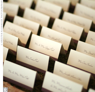 A moss birch box held ivory cards trimmed in brown ribbon printed with each guest's name.