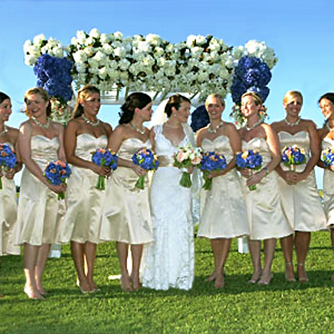 Alex's eight bridesmaids wore strapless, satin, tea-length, Badgley Mischka dresses.