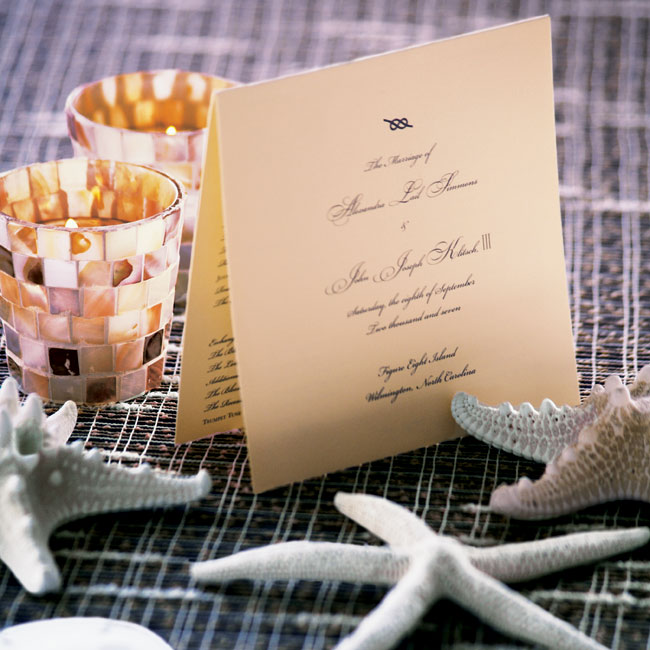 The simple, folded programs were printed with navy blue ink and featured a knot motif at the top.