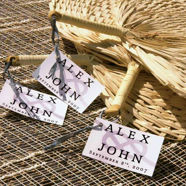The couple provided round fans tagged with their names and the wedding date so guests could cool themselves off during the ceremony.