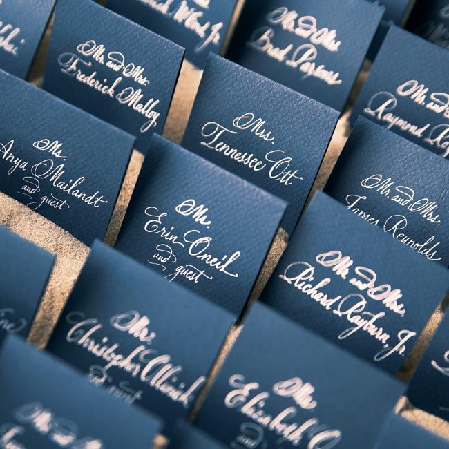 The way the couple set up their navy blue and white escort cards, placed upright in a box of sand, was inspired by an idea they'd found in a wedding magazine.