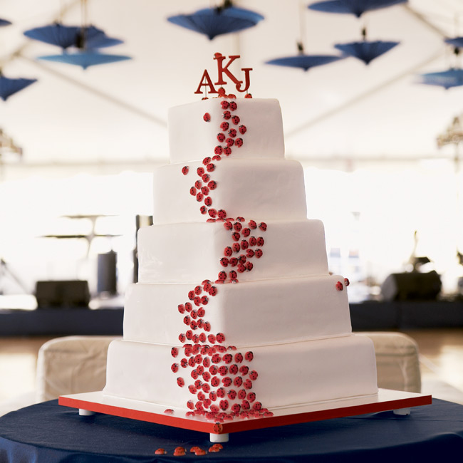 "The white wedding cake was decorated with red ladybugs that appeared to be crawling up the side of the confection (Alex's nickname has been ""ladybug"" since she was a little girl). Guests enjoyed alternating layers of German chocolate and white cake."