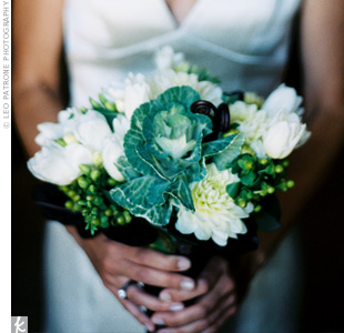 Nicole's bouquet was made up of green and white blooms like kale, tulips, dahlias, ranunculus, hypericum berries, and brown fern curl wrapped in brown grosgrain.