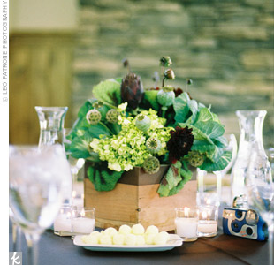 Like the bride's bouquet, Nicole and Tyler's centerpieces combined vegetables and flowers, like hydrangeas, kale, artichokes, dahlias, poppy pods, scabiosa pods, fern curl, and begonia leaves.