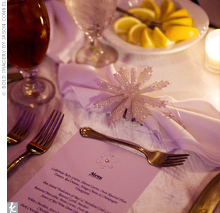 Heather and her bridesmaids designed the menu cards, which had snowflake and crystal detail. The favors, snowflake ornaments and snowflake wine stoppers, sat behind white, pleated napkins.
