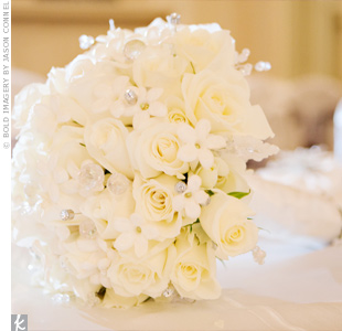 Heather carried a wintry mix of white roses, white stephanotis, diamond stems, crystals, and snowflakes.