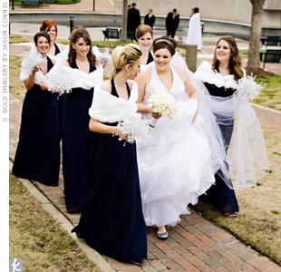 Heathers bridesmaids wore chiffon, beaded, halter dresses with shirred midriffs and A-line skirts. White fur wraps cinched with a silver snowflake pin kept them warm.