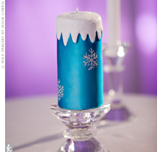 Heather and Michael lit a blue unity candle with silver snowflakes to signify their union.