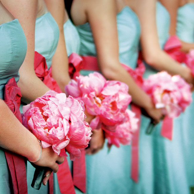 The bridesmaid bouquets were made up of pink peonies tied with a robin's egg blue silk ribbon.