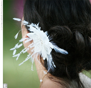 Stacie wore her hair swept back into a loose, romantic bun with a silk flower with feather accents tucked into the left side.