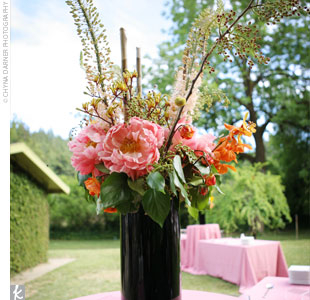 Lush pink peonies were combined with orchids, seeded eucalyptus, and other blooms for a natural, just-picked look.