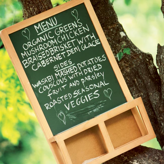 A chalkboard listing the evening's tasty menu hung from a tree outside the reception area.