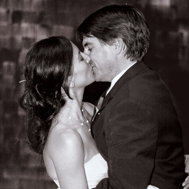 """Stacie and Keith swayed to """"Can't Get Enough of Your Love"""" by Barry White for their first dance."""