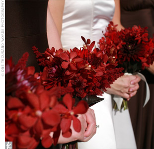 The bouquets were filled with vibrant red dahlias and James Storei orchids.