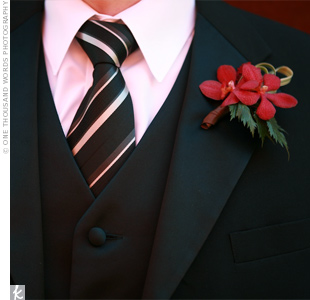 The guys wore red Vanda orchids with greenery on their lapels.