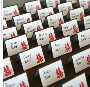 "The Chinese character for ""double happiness,"" which is a traditional image in Chinese weddings, was printed on the escort cards. One of Breena's bridesmaids, Cesilia, did the calligraphy."