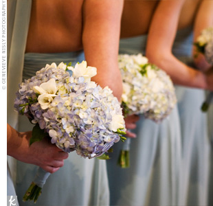 The Bridesmaids Carried Bouquets Of Blue Hydrangeas And Lisianthus To