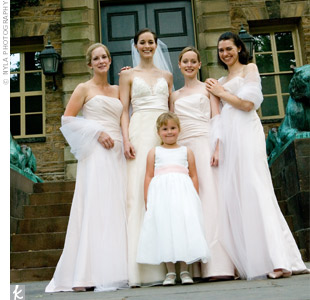 The three bridesmaids wore strapless, A-line gowns with a side-draped bodice made of pale pink tissue taffeta.