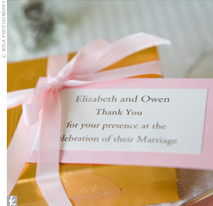 Boxes of Godiva chocolates were tied with pink ribbon and a note of thanks was tucked under the ribbon of each box.