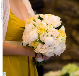 The bridesmaids carried yellow bouquets of ranunculus.