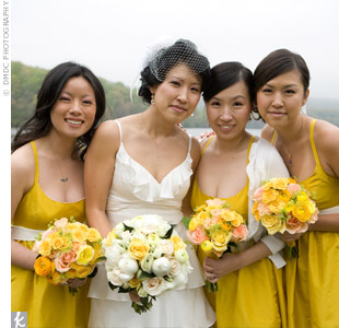 The bridesmaids wore yellow, cocktail length, silk taffeta dresses, to which Susan added cream colored sashes to break up the intensity of the color.