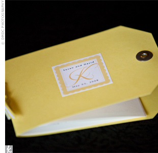 The programs were made from yellow hang tags and were bound with yellow and white striped grosgrain ribbon. Each program had a sticker on the front with the bride and groom's names and wedding date.