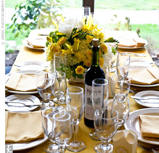 The tables were covered with white linens and yellow table runners with matching napkins.