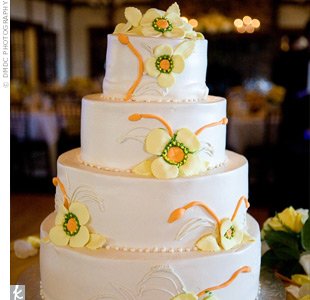 The four-tiered chocolate cake with strawberry and banana filling had white creme frosting and was decorated with yellow flowers.